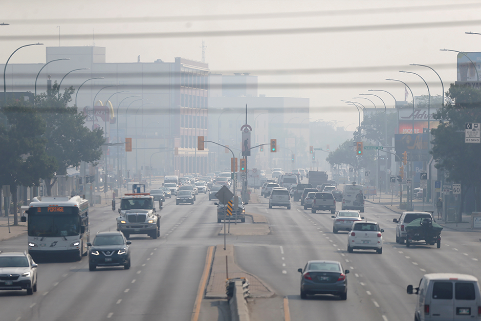 Haze from wildfires covers Portage Avenue in Winnipeg, Manitoba, Canada, on July 29.
