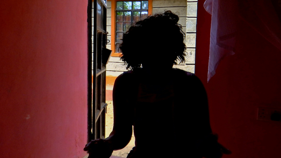 silhouette of woman in doorway