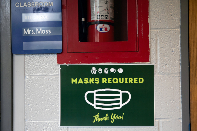 photo of sign in school saying masks are required