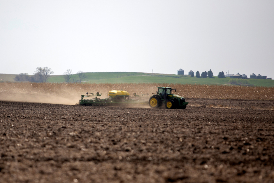 photo of tractor plowing field