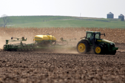 photo of tractor planting field