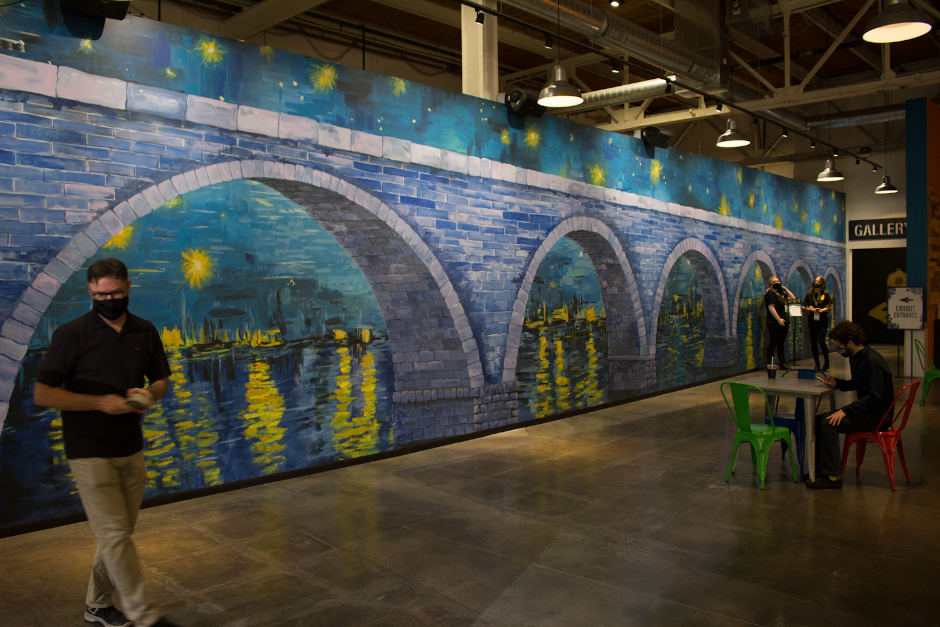 image of mural with stone arch bridge painted in vaguely van gogh-like style