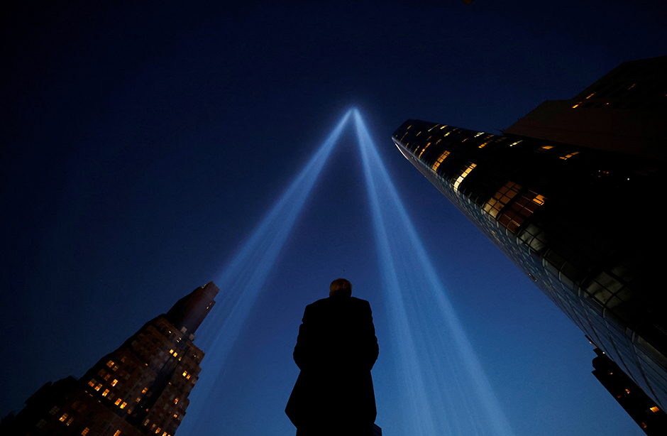 A person taking pictures of the Tribute in Light art installation in New York City on September 11.