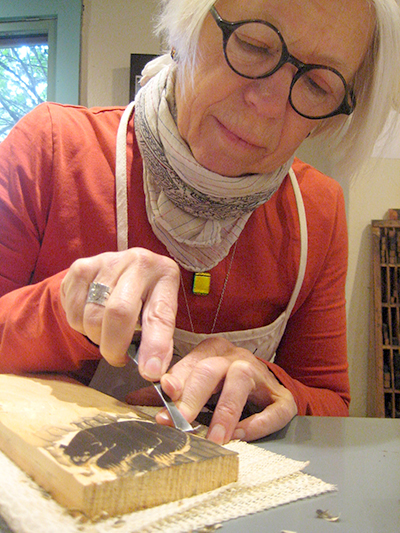 Woodcut artist Betsy Bowen at work in her studio in Grand Marais.