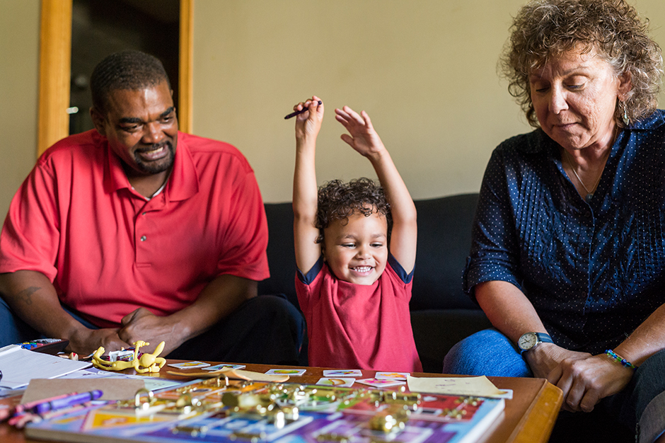 A father and son shown during a visit from a St. David's Center for Child and Family Development professional.