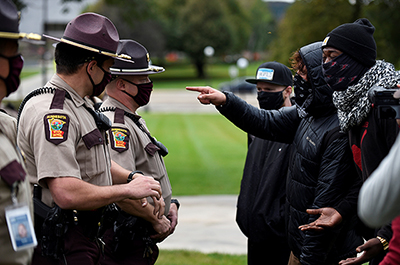 Counter protesters confront Minnesota State Patrol officers
