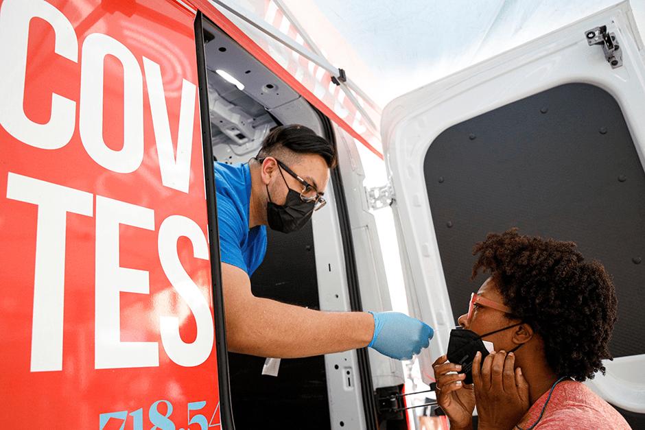 Akyiaa Wilson receives a coronavirus disease test from technician Adrian Gutierrez at a mobile testing van in New York City in August.