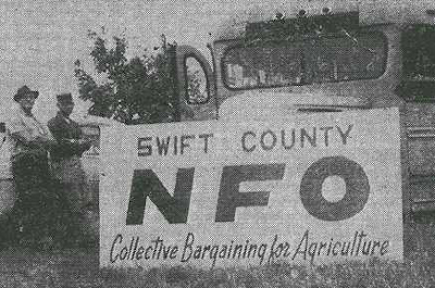 image of farmers standing by truck with large NFO sign supporting collective bargaining