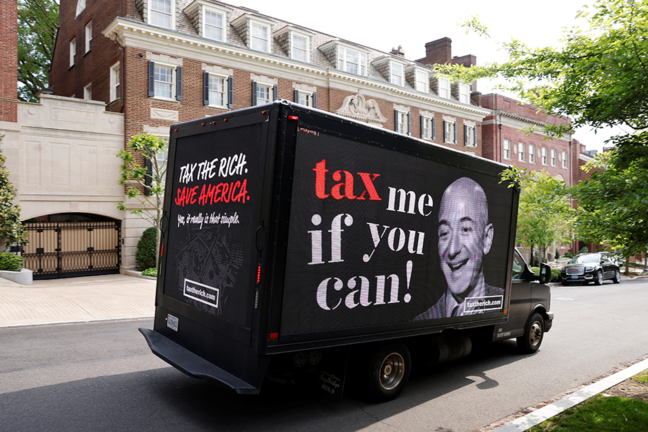 A video protest sign on a truck paid for by the Patriotic Millionaires driving past a mansion owned by Amazon founder Jeff Bezos, in Washington, D.C., on May 17.