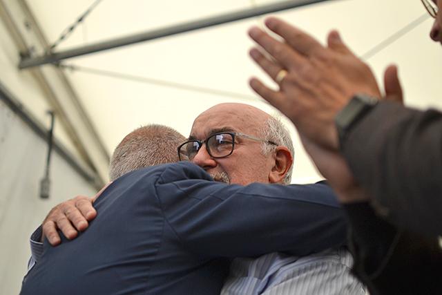 State Sen. David Tomassoni, right, hugging Heliene CEO Martin Pochtaruk during Thursday's ceremonies.
