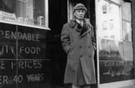 image of man in coat standing outside restaurant