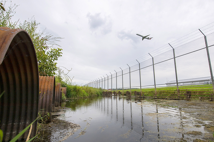An airplane takes off near the site where Starkweather Creek exits Truax Field Air National Guard Base and flows through pipes that feed the water downstream toward Lake Monona.