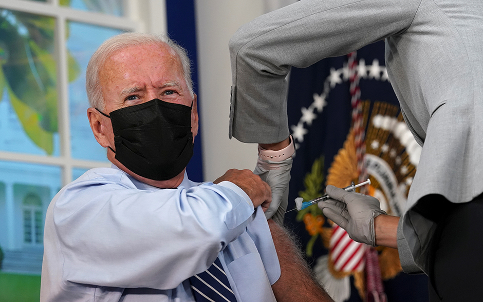 President Joe Biden receiving his COVID-19 booster vaccination at the White House on Monday.