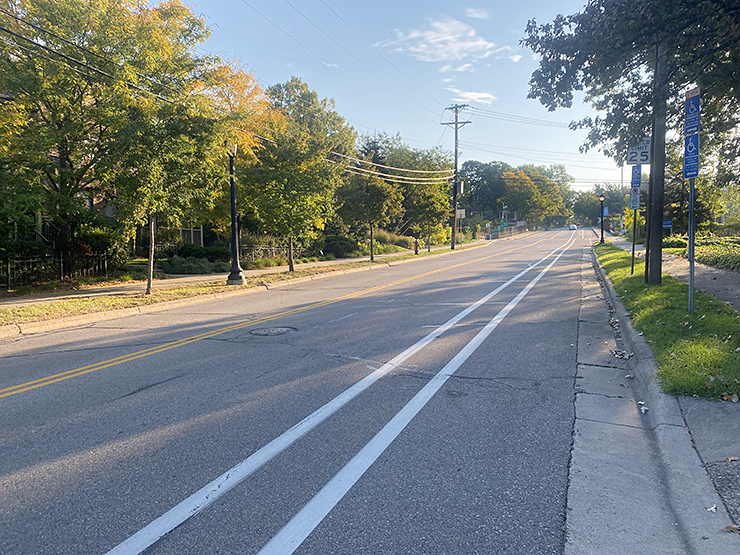 The photo shows the way up the hill with the bike lane on the right