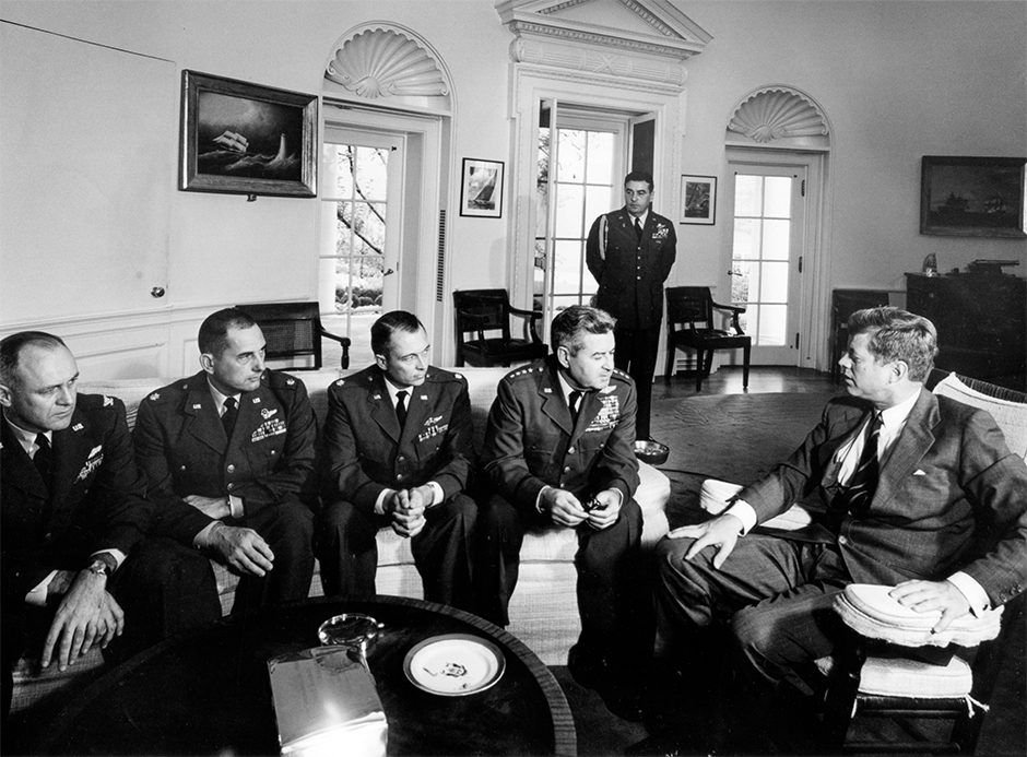 President Kennedy meeting in the Oval Office with General Curtis LeMay and the reconnaissance pilots who found the missile sites in Cuba on October 30, 1962.