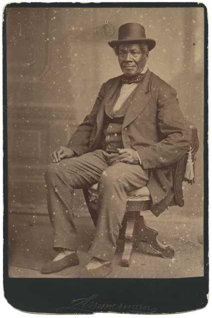 photo of george bonga seated