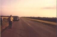 image of sheriffs deputy standing on road