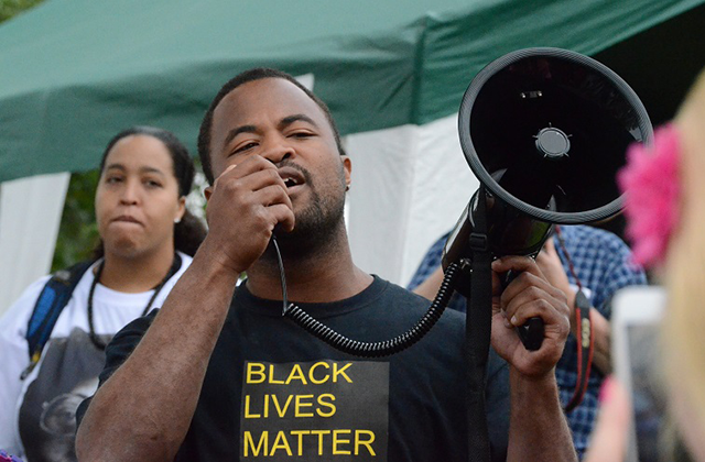 BLM organizer Rashad Turner speaks to the crowd at Hamline Park.
