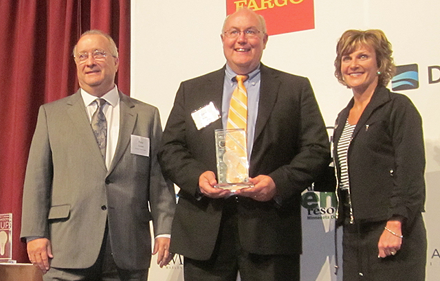 Dave Roeser of Garden Fresh Farms, center, winner in the Energy/Clean Tech category