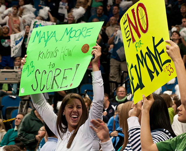 Sign-waving fans of Maya Moore and Seimone Augustus