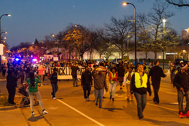 Protesters marching down Plymouth Avenue North