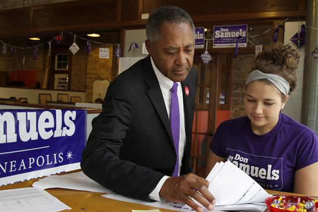 Don Samuels and a volunteer at his campaign headquarters on Election Day.