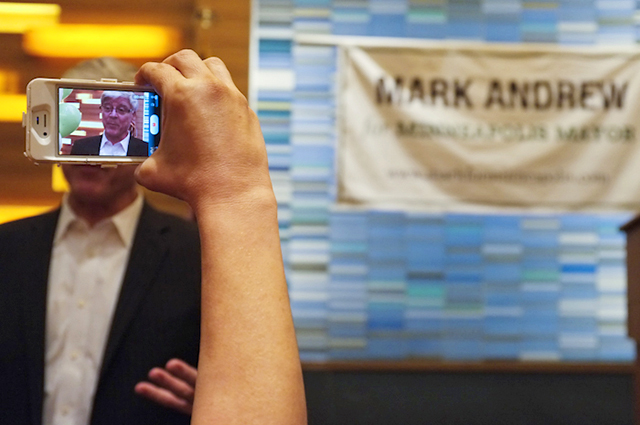 Mark Andrew having his picture taken during a campaign party at the Graves 601 hotel.