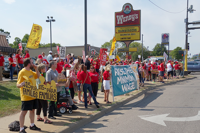 Activists gather at a Minneapolis fast food restaurant last September