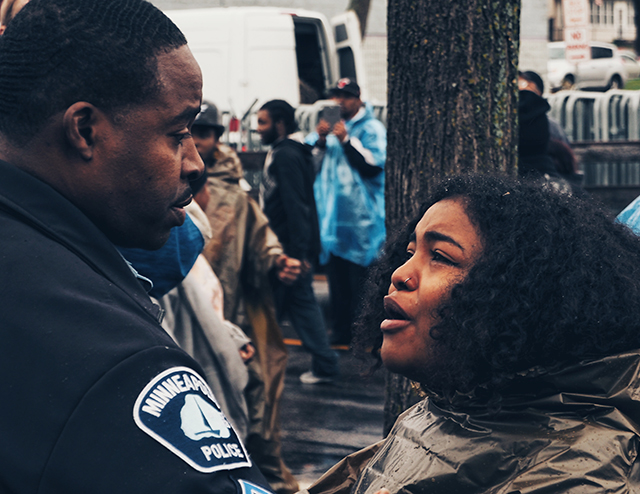 A Black Lives Matter supporter confronting a Minneapolis police officer