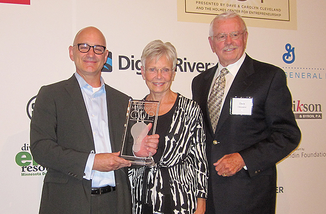 Grand prize winner Steve Anderson with presenters Carolyn and Dave Cleveland
