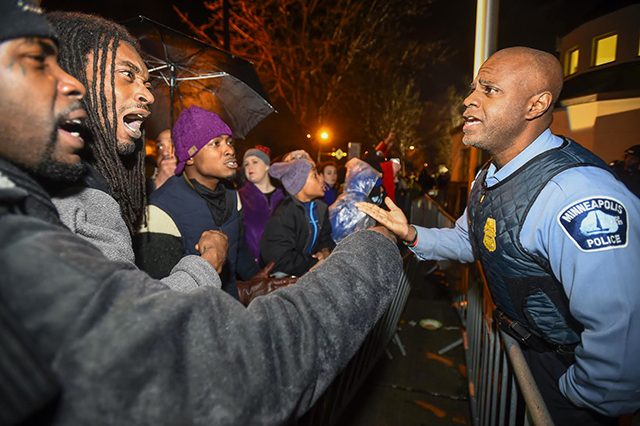 A police officer talks with demonstrators