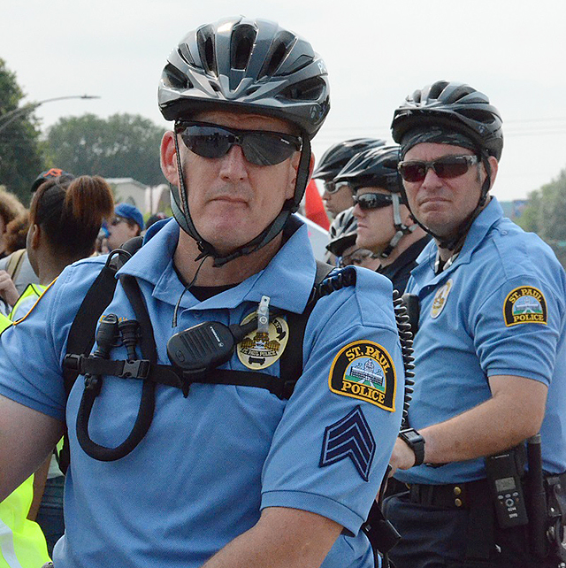 St. Paul police follow along the march on bicycles