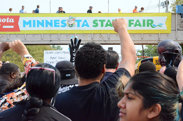 Marchers cheered as they arrived at the gates of the State Fair.