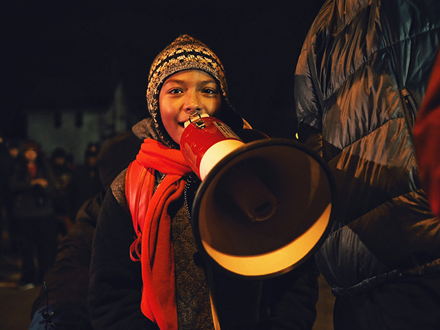 A young protester gets their turn on the megaphone.