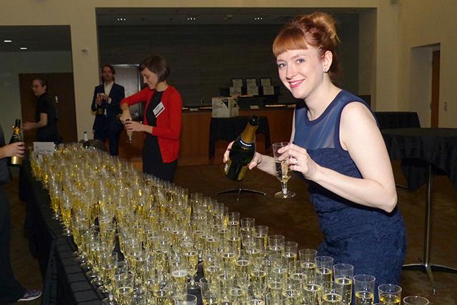 Event volunteer Emily Dussault serving up the Champagne