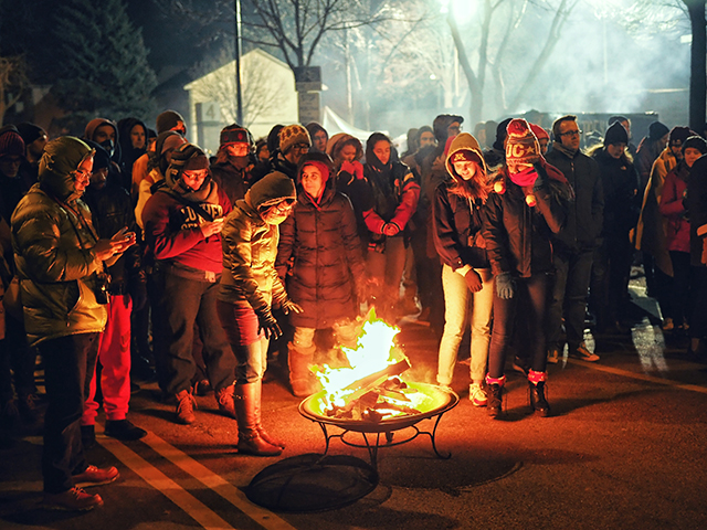 Protesters surrounding a fire outside the police station on Thursday night.