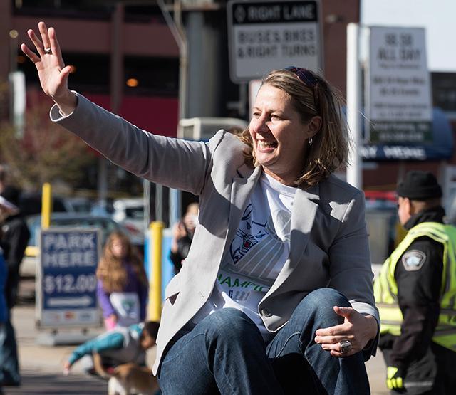 Head Coach Cheryl Reeve waving to the crowd along Hennepin Avenue.
