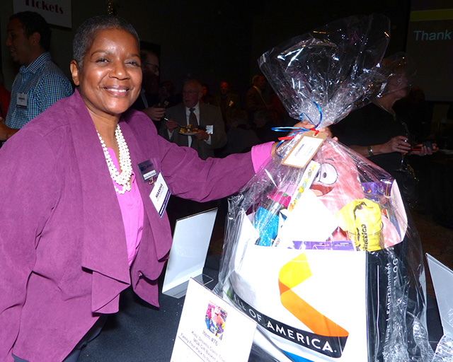 Marsha Pitts-Phillips checking out the Mall of American silent auction package
