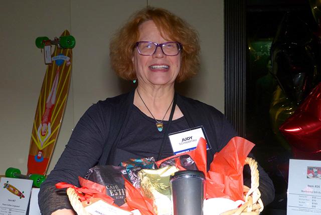 Judy Schwartau claims her loot as the winner of the Starbucks coffee package