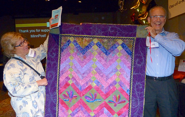 Claudia and Tom Freund walk away with a one-of-a-kind quilt
