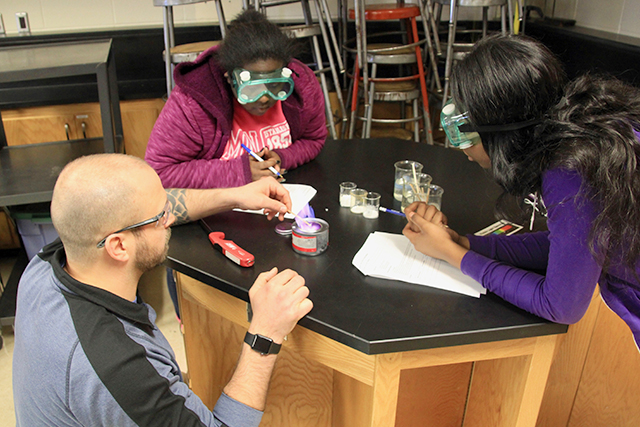 Abe Cass, lower left, teaching lab in 9th grade physical science class.