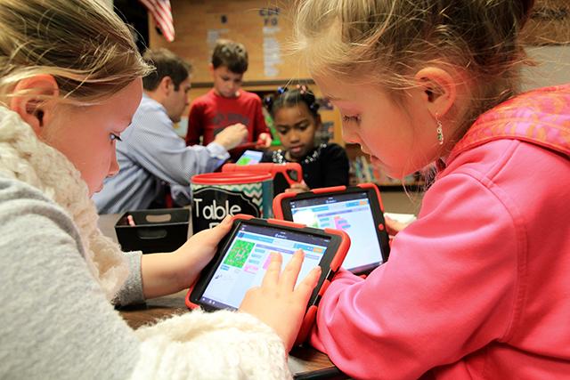 Kendall Malin, 8, helps Ada Geisler, 8