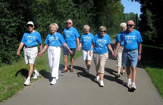 The Jolly Walkers of Albert Lea enjoying a walk on a footpath.