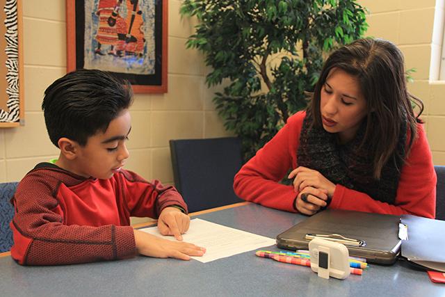 Second-grader Alejandro working with tutor Jenny Nyberg.