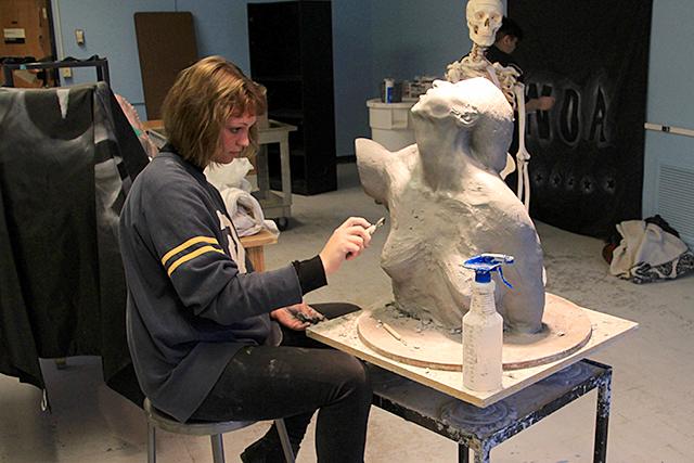 Allison Baxter, Grade 12, working on a sculpture.