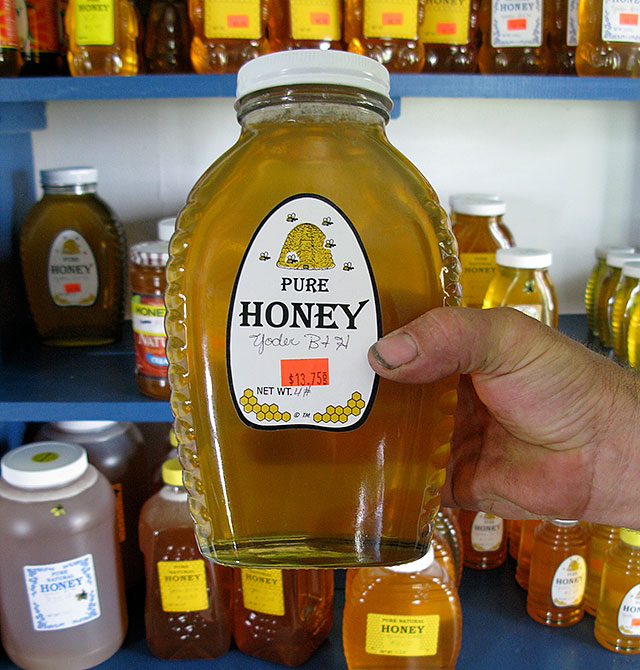 Eli Yoder holds up an example of his best-selling honey product