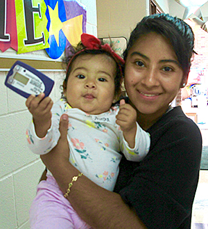 Nadia Barrientos holding her 10-month-old daughter.