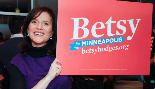 Betsy Hodges holding lawn sign