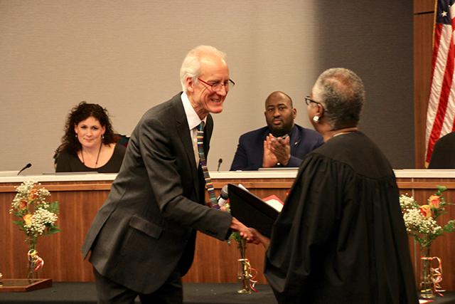 Bob Walser, left, being sworn in by Judge Pamela Alexander.