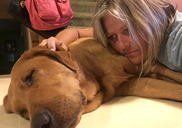 Bonnie Gallagher shown with her dog, Scout.